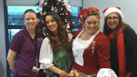 Russo joins Hill, Lange, and Hill's daughter in this picture at Children's Hospital Central California's play room.