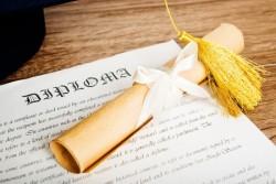 diploma and grad hat