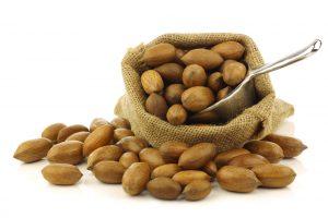 Tasty pecan nuts in a burlap bag