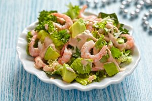 Fresh green salad with shrimp and avocado